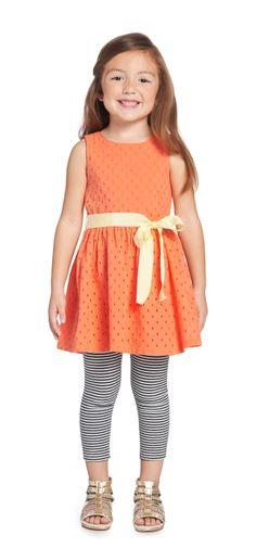 SPRING EYELET DRESS Eyelet sleeveless dress with full skirt and grosgrain pastel ribbon around waist. Back zipper for easy dressing. Fully lined in light weight poplin.