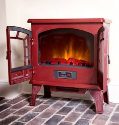 A unique forest green electric fireplace stove. http://www ...