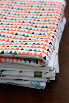 pretty fabric - teal, orange/coral, light blue, gray?