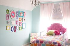 Toddler Girl Bedroom, love the colorful frames, harley loves this one!
