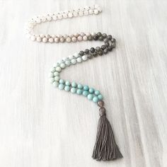 Amazonite + Aquamarine + Labradorite + Agate + Quartz Mala. A powerful combination of stones that help with communication, truth, balance, strength, courage, protection and healing. Come to the #jackalopeartfair on April 16th and 17th to purchase any of my malas. With each Mala you'll get a full description of each stone and it's healing properties along with information about malas and how awesome they are !!!