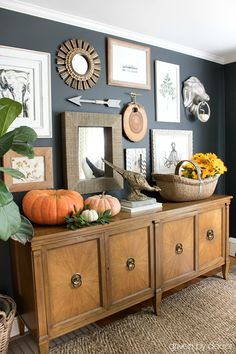 Home office gallery wall with pumpkins and sunflowers for fall