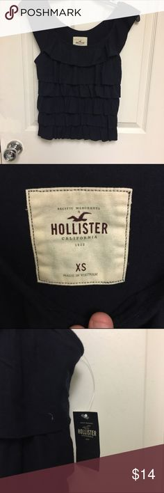 A Hollister navy blue tank w/ruffles on the front NWT  I also have another one in a size small. However, it doesn't have the tags but it is still New Hollister Tops Tank Tops