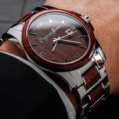 The perfect combination of style and class, this watch features polished stainless steel and radiant red rosewood. The anytime, anywhere, always... http://amzn.to/2sqEwBW