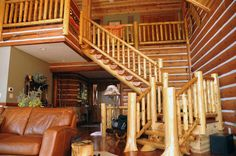 custom built log stair case in this hybrid log home.  Detail - the chinking between the logs on the walls
