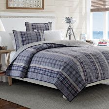 Nautica Tiller - A gorgeous navy cloud dressed in a sea of stripes. Reverse side offers a traditional, windowpane plaid.