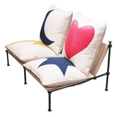 Hearts, stars, moons, lightning bolts on a loveseat?! Why not! By Jean-Michel Wilmotte