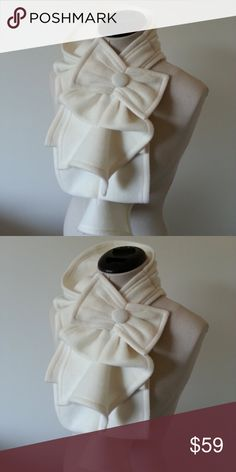 Fleece Ruffle Scarf with Bow Detail in Creme Stunning and unique fleece ruffle scarf with bow. Put this scarf around your neck and simply put the button thru the loop.  The design is beautiful with a coat, denim jacket or a blouse. Accessories Scarves & Wraps