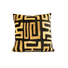 This brown and natural Kuba-cloth pillow is also known as raffia cloth. The Kuba artisans of the Congo hand cut, dye (using mud, indigo, or substances from the camwood tree), and then weave the strips