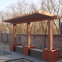 Pergola with planters and seating