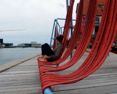 Public installation Off-Ground consists of hanging materials that can be turned into a hammock, low seat, or a swing.