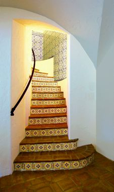 Love the Mexican-style staircase with decorative tiles