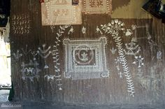 Warli painting on hut wall Dahanu Thane Maharashtra India