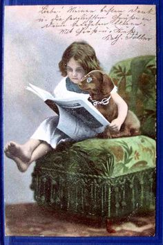 1902...Picture of a girl and her dog...reading together.