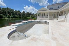 Travertine pavers are a popular choice for pool decks thanks to their attractiveness, non-slip surface, and tendency to stay cool even on hot sunny days. Pool Pavers, Backyard Pool Landscaping, Concrete Pool, Landscaping Ideas, Patio Ideas, Backyard Ideas, Outdoor Pavers, Pool Tiles, Paver Walkway