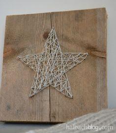 Stern aus Silberkordel und Nägeln auf grobem Holz - stylisher Begleiter für den…