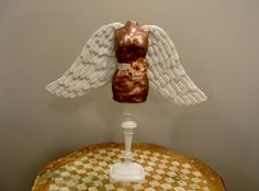 My personal favorite: copper and white angel art doll