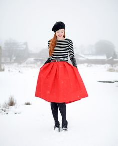 retro-inspired winter outfit: red skirt, breton top and black beret