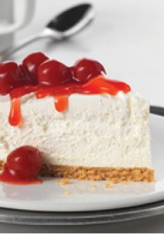 Fluffy Cheesecake — Whipped topping gives this cherry-topped no-bake cheesecake recipe its amazing height. Fluffy? Yes. But it's sure to dominate the dessert table.