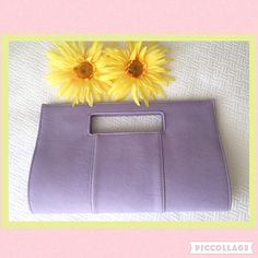 "Lavender clutch purse. Never used. Sweet little lavender colored clutch purse with nice stitching. Perfect for spring. Never used. Excellent condition. Snaps shut at top. Interior lining is sky blue and has one zippered area. Measures appx 12.5"" across and 8"" down. Charming Charlie Bags Clutches & Wristlets"