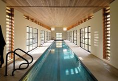 Competitive swimmer Sydne Didier commissioned Austin Design Inc. to create a 102-foot-long pool house in a freestanding structure behind her Amherst, Massachusetts, house.