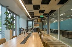 Space Matrix, an office design company, was engaged by Asia's largest business space planner, Ascendas-Singbridge, to design their offices located in Cool Office Space, Office Spaces, Space Photos, Task Lighting, Singapore, Offices, Design Inspiration, Flooring, Cool Stuff
