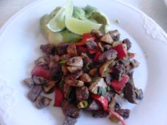 Beef bits with red bell pepper, mushrooms and spring onions roasted in olive oil with salt, pepper, chili, cumin and some avocado with lemon on the side. Drizzled lime juice over both the avocado and the meat and veggies to counter the strong spices a little. Yummy :)