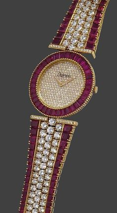 DeLaneau a fine and rare 18K gold, diamond and ruby-set bracelet watch