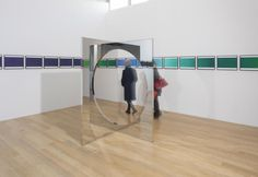 Jeep Hein, Geometric Mirrors II, 2010 and Olafur Eliasson, The colour spectrum series, 2005. Installation view: Another Minimalism: Art After California Light and Space at The Fruitmarket Gallery, Edinburgh