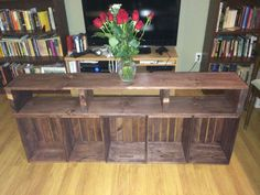 """Wooden Crate Entertainment Center  The unit measure 9¼""""w x 62½""""l x 26¾""""h. I leave the cross supports an extra 1/2"""" in the back so that wires can go from the back of the unit while flush against the wall.  The top wood can be built wider at 11 1/8"""" wide though it will over hang the crates."""