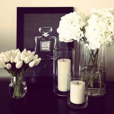 Fresh White Flowers as Decor in Glass Vases to Match the Candles