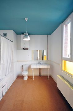 Refurbishment, Antwerp by Bovenbouw architecture spindle legs and ceiling colour