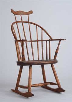 Windsor Style Oak, Maple and Pine Comb-Back Rocking Chair   40 x 23 1/2 x 24 1/2 in.   Estimate $ 400-600  Sold for $ 150