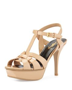 """Tribute Patent Leather Sandal, Darker Nude by Saint Laurent at Neiman Marcus.  Saint Laurent Tribute Patent Leather Sandal, Darker Nude      Saint Laurent """"Tribute"""" sandal in patent leather.     4.3"""" stiletto heel; 1"""" platform; 3.3"""" equiv.     Wide straps loop together over vamp.     T-strap connects to ankle strap.     Adjustable buckle closure.     Golden hardware.     Leather lining and sole.     Made in Italy.  $895.00"""