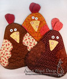 Laura, can you make a couple of these for me?  I'll cut out the pieces. (Potholders or mug rugs)