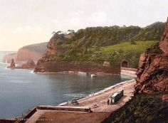 Bathing cove, Dawlish, England between 1890 and 1900 (notice the Victorian wheeled bathing machines on the beach)