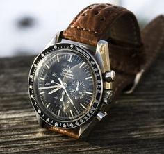 Omega watch with leather strap.