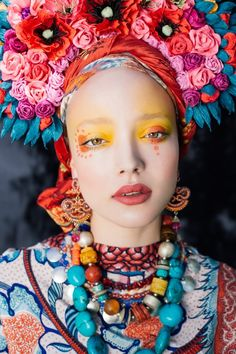 """From the bright beads to the bold makeup to the bouquets balanced as exuberant crowns, these photographs byUla Kóska are rich with color, pattern, and texture. Created in collaboration with makeup artist, stylist, and costume designer Beata Bojda, the images comprise a series called Etno, an abbreviation stemming from the word """"ethnography."""" Kóska and Bojda have paid homage to their shared Polish roots by featuring craftsmanship that's likely to surprise those unfamiliar with the country's…"""