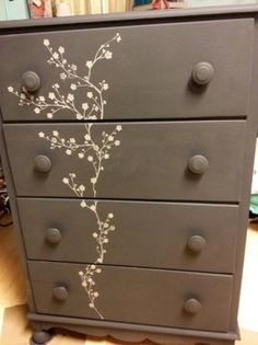 Vintage dark grey dresser with hand-painted blossom accents. This listing is for a vintage dresser, painted in Annie Sloan Graphite Chalk Paint and accented with light grey blossoms. Solid wood,...