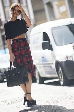 Miroslava Duma in cropped top & tartan skirt