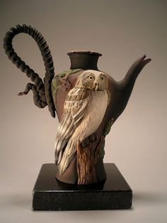 Owl teapot. Nancy Adams ceramics  oooo  for a moment I saw a person with his arms raised