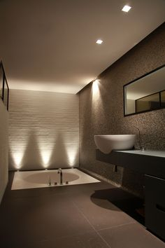 Dramatic up lighting accents sculptural wall tiles - Villa T - BJARNHOFF A/S #bathroombeauties