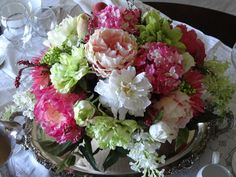 SILVER TRAY AND PRETTY PALETTE OF PINKS , WHITES AND GREENS.