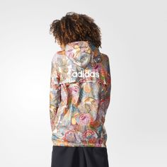 This women's windbreaker is a wearable work of art with a vibrant Balinese-inspired print. Designed with Brazilian label The FARM Company, jungle flowers, fruit, and birds swirl on this jacket. Features lightweight material, kangaroo front pockets, and a contrasting, oversize Trefoil on the back.