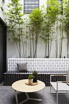 Doherty Design Studio's Commercial Road Residence Courtyard. Photographer: Armelle Habib I Outdoor area designed by Nathan Burkett Design - Great material & colour choices I Tait Nano table in foreground http://madebytait.com.au/