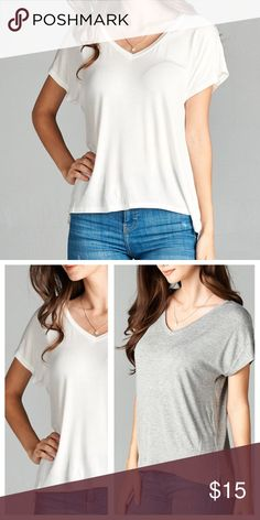 🆕Staple Ivory V Neck Tee Basic v neck tee that is a classic wardrobe staple! Features dolman short sleeves, high low cut, slight side slits. Soft & stretchy fabric. Rayon, Spandex. Slightly relaxed fit. Tops Tees - Short Sleeve