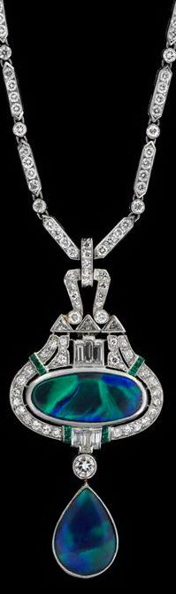 Art Deco platinum, opal and diamond necklace   Elongated hexagonal link, separated by collet set diamond link finishing in an oval black opal pendant, framed within a petite round cut diamond frame accented by triangular cut diamond, caliber emerald accent and finishing in a single black pear shape opal.