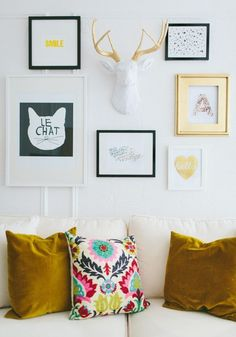 Add dimension to a gallery wall with a faux animal head in complimentary colors,