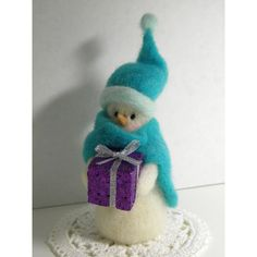 Warmly Wrapped Gift Bearing Needle Felted Wool Christmas Decoration Snowman. $17.00, via Etsy.