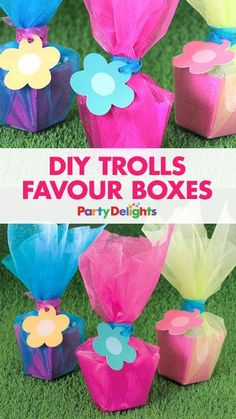 Trolls is one of our favourite kids' party themes! If you're planning a Trolls party, have a go at making these cute DIY party favours with a a small favour box and brightly coloured organza.